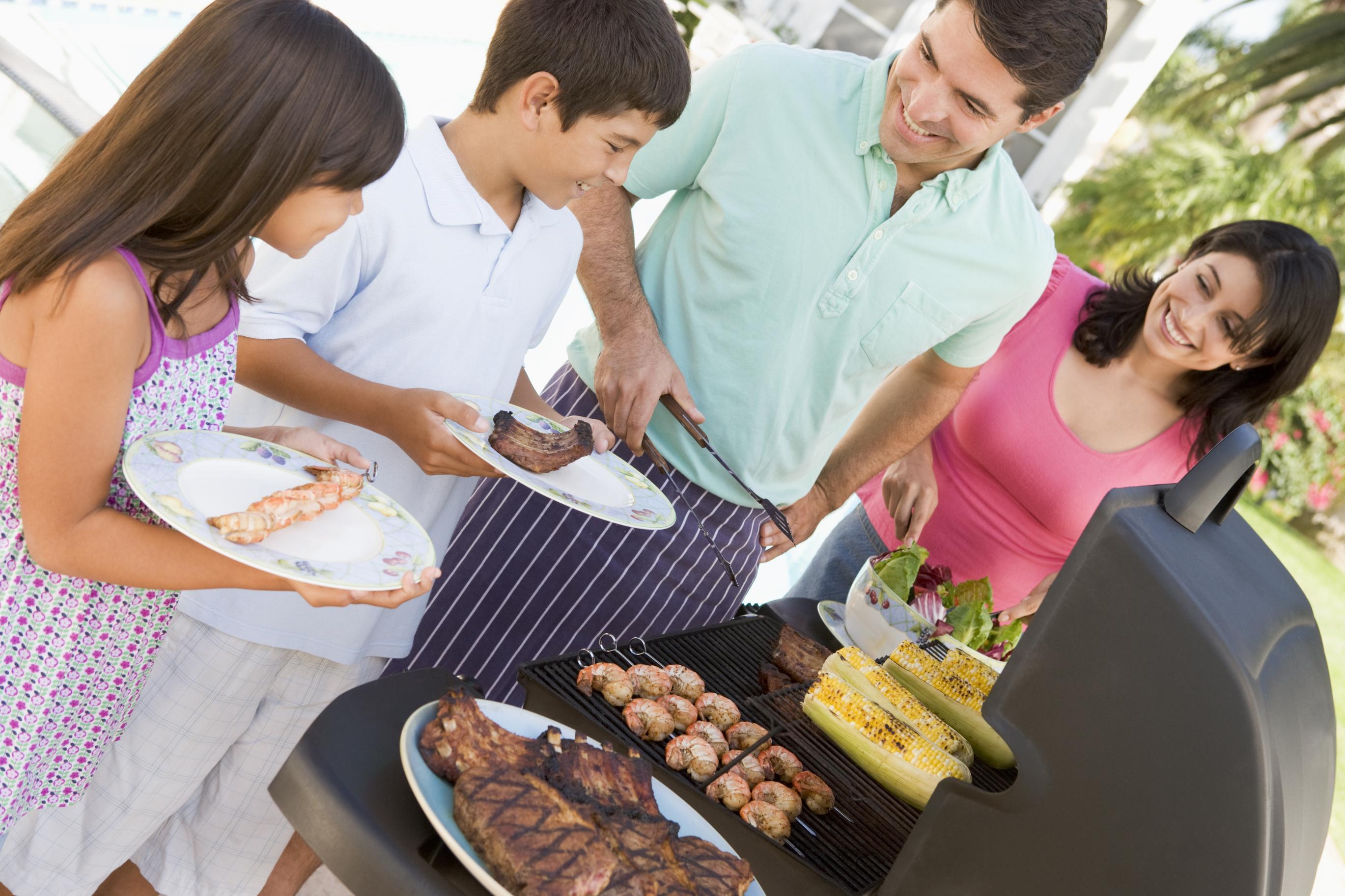 Family enjoying a barbecue.