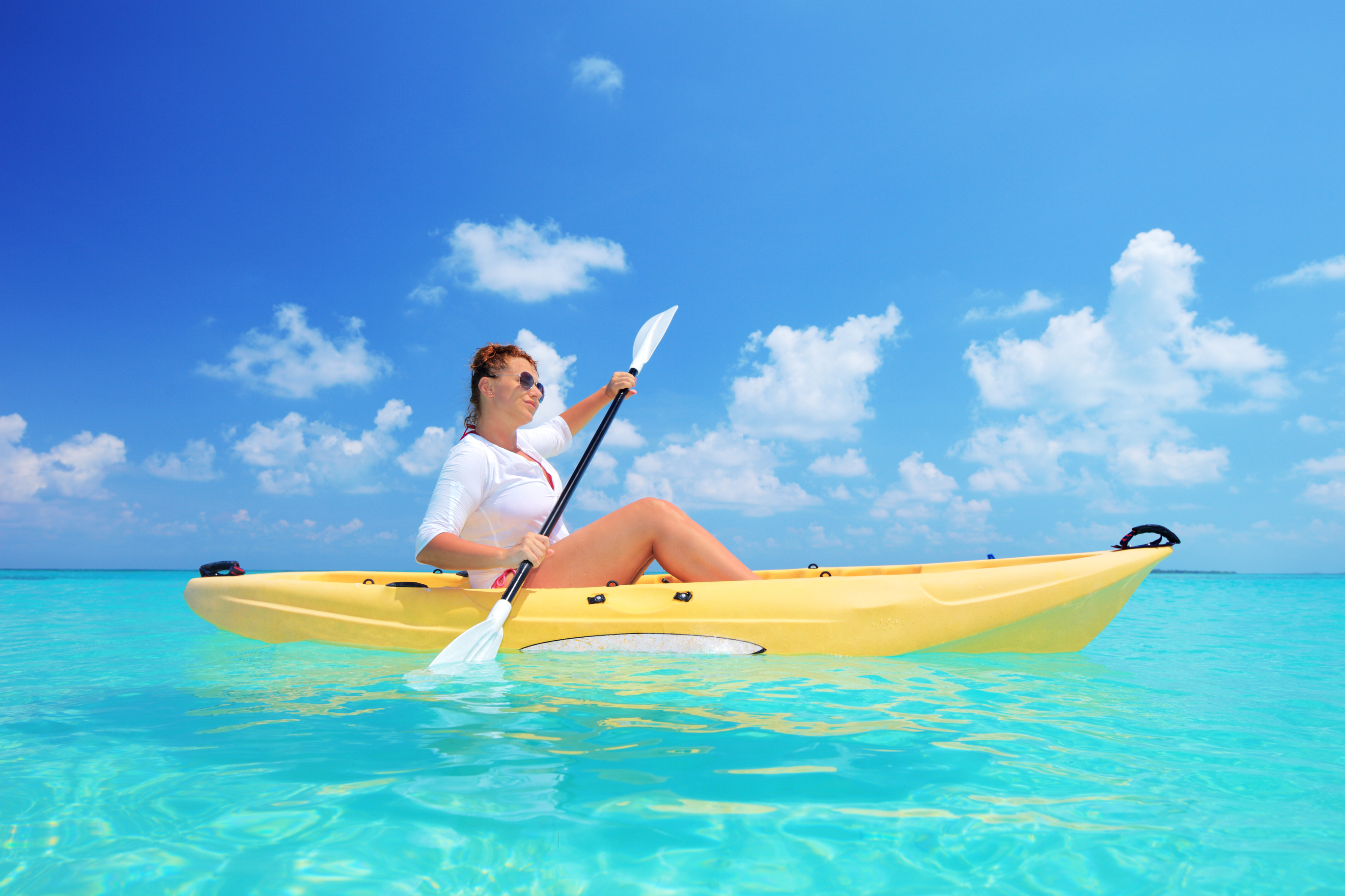 Woman kayaking on a sunny day.
