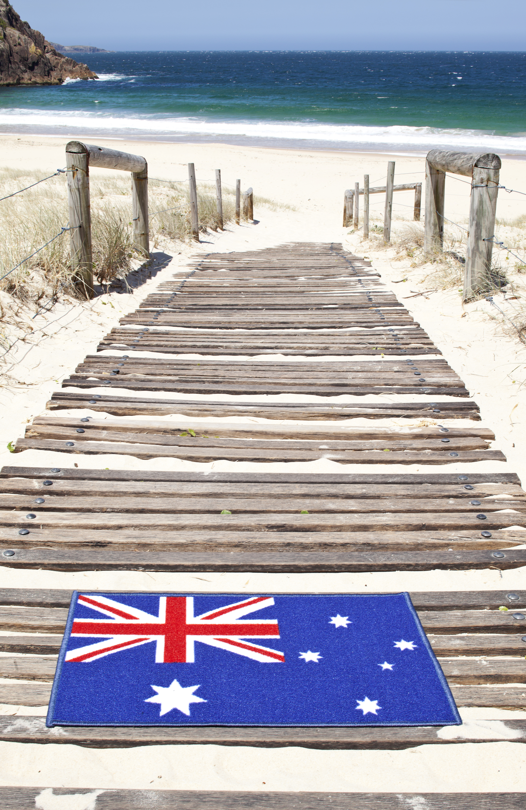Australian flag wlecome doormat at the beach.