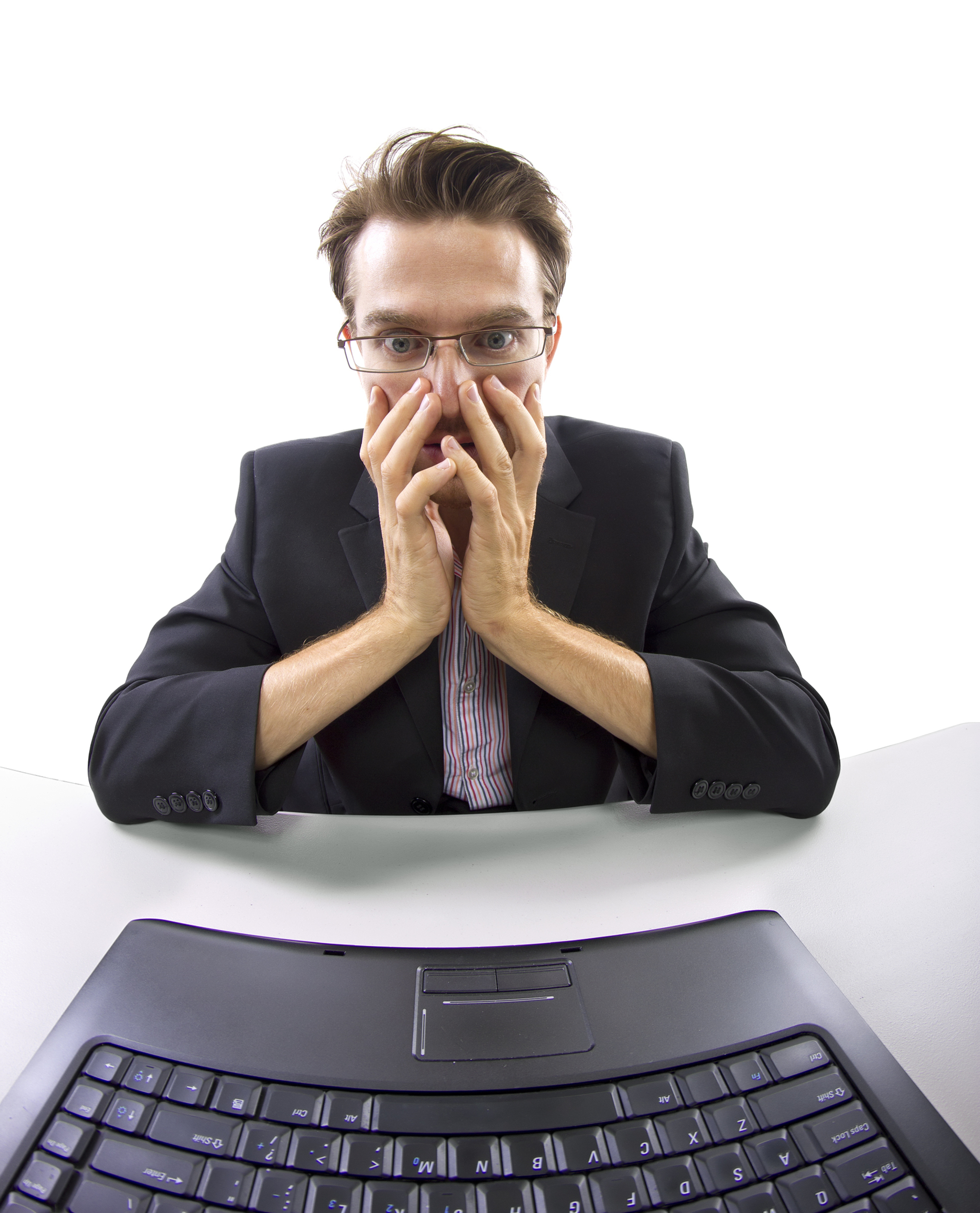 Man stressed looking at a keyboard.