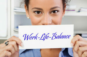 Women Holding a Work Life Balance Post