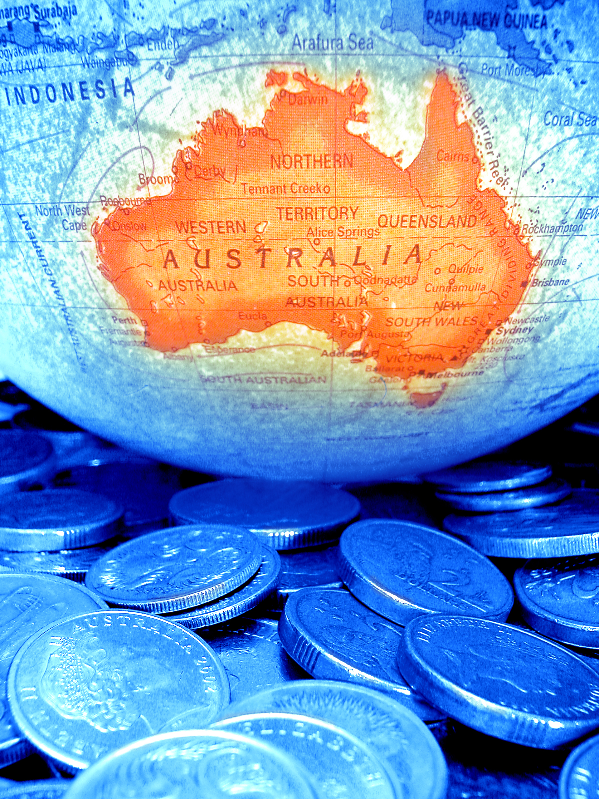 Image of Australian money and a globe.