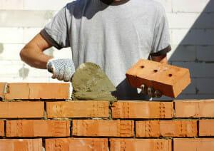 Man building with bricks