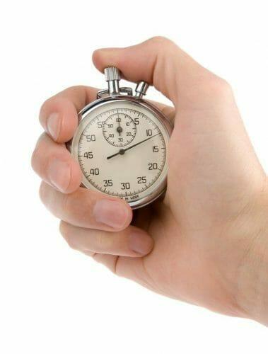 Hand starting a clock timer.