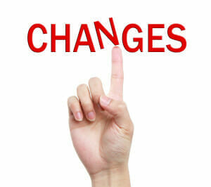 Index finger pointing at the word Changes