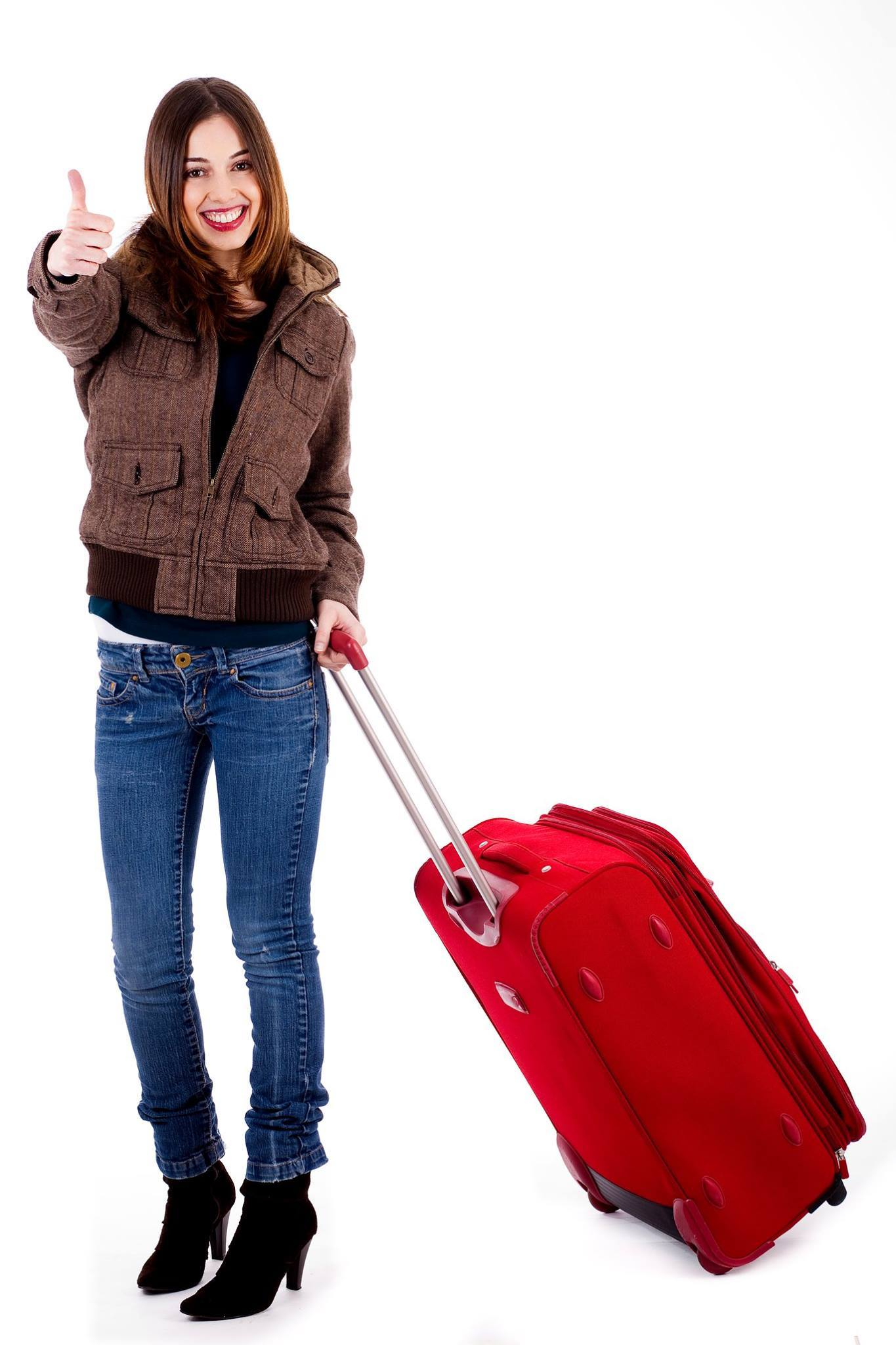 Women with thumbs up and travel bag ready.