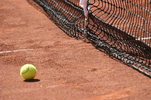 Tennis ball on a tennis field.