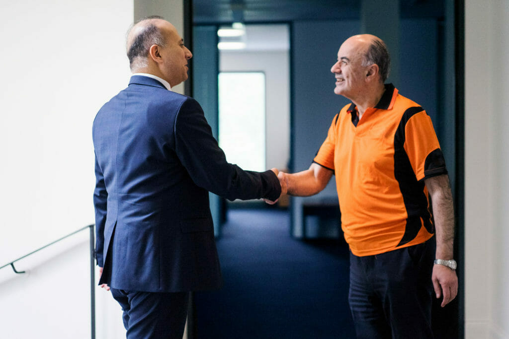 Two mens giving a handshake