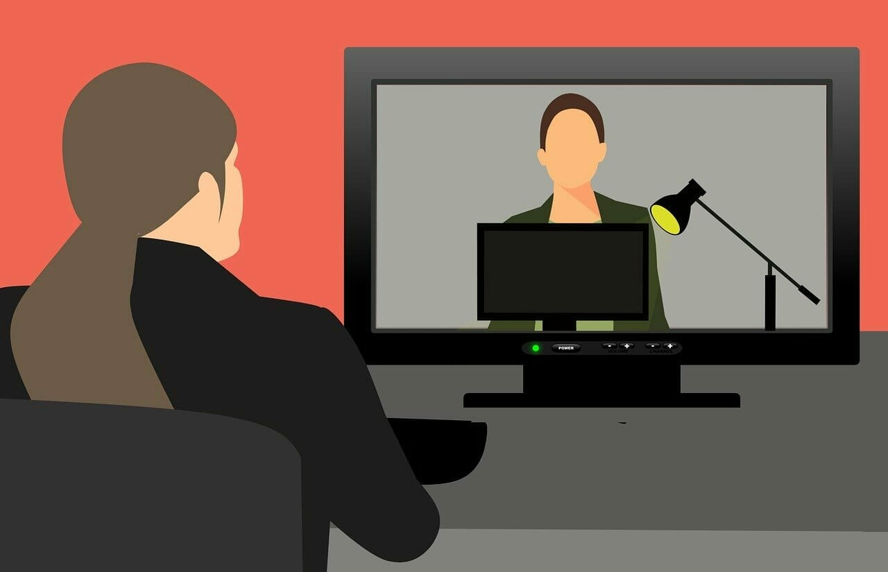 Person in suit doing video conference