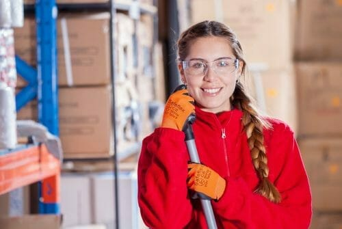 Girl holding brush in warehouse