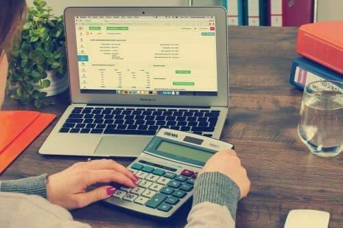 Woman lodging tax return on computer
