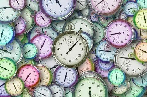 Dozens of coloured clocks