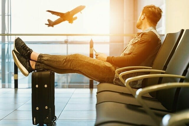 Plane taking off, person waiting in airport, Australian travel exemption