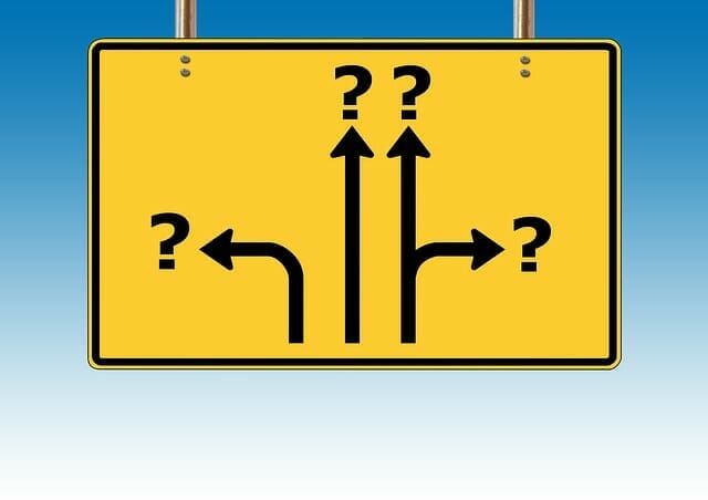 sign post with question marks