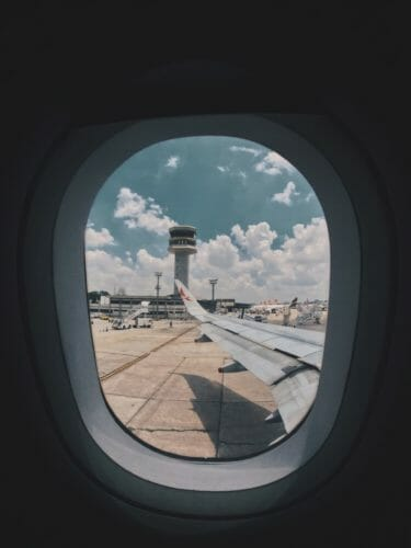 Looking out of plane window.